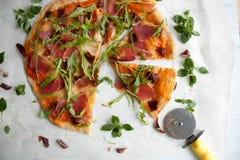 Pizza with tomato sauce, prosciutto and arugula. Perfect healthy lunch idea: Pizza with tomato sauce, prosciutto and arugula stock photography