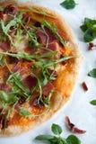 Pizza with tomato sauce, prosciutto and arugula. Perfect healthy lunch idea: Pizza with tomato sauce, prosciutto and arugula stock photos