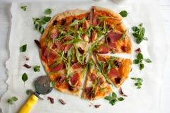 Pizza with tomato sauce, prosciutto and arugula. Perfect healthy lunch idea: Pizza with tomato sauce, prosciutto and arugula stock images