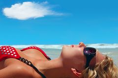 Perfect Holidays. Girl is lying on the sun Royalty Free Stock Photography