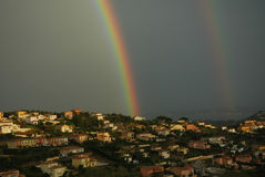 The perfect house. Rainbow lights up the a house in Sainte Maxime, France royalty free stock image