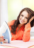 Perfect housewife ironing clothes Stock Photography