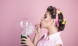 Perfect housewife. pin up woman with trendy makeup. pinup girl with fashion hair. retro woman drink summer cocktail. Pretty girl in vintage style. bubble stock photo