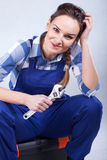 A perfect housewife repairing Royalty Free Stock Photography