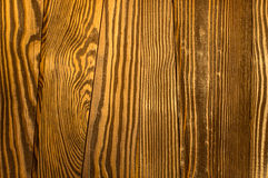 Perfect irregular old and rough wood timber surface texture back. This decently polished wood background texture has a beautiful irregular and natural ambience Stock Photo