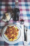 Perfect italian meal. A Dish of pasta with a glass of red wine Is the perfect italian meal Royalty Free Stock Photo