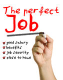 The perfect job. A man writes writes a list of requirements for the perfect job such as: good salary, benefits, job security and close to home stock photography