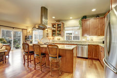 Perfect kitchen with hardwood floor and island. Stock Image
