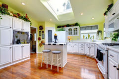 Perfect kitchen with white interior, yellow walls, and hardwood Royalty Free Stock Images