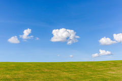 The perfect landscape of green grass field and white fluffy clou Stock Photo