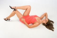 Perfect legs. Young woman lying on her back featuring perfectly shaped legs Royalty Free Stock Image