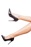 Perfect legs in black shoes isolated over white background Royalty Free Stock Photography