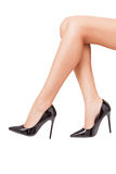 Perfect legs in black shoes over white background Royalty Free Stock Photography