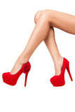 Perfect legs in red shoes with high heels isolated on white back Royalty Free Stock Image