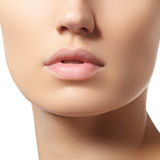 Perfect lips. Sexy girl mouth close-up. Beauty young woman. Natural full lips Royalty Free Stock Photography