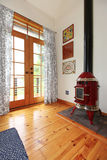 Perfect little red fireplace in hardwood room. Perfect little red fireplace in hardwood room with glass door Royalty Free Stock Image