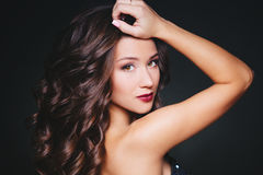 Perfect make-up and hairstyle. Portrait of beautiful curly brunette woman Stock Photography