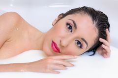 Perfect make-up woman in milk bath stock image