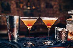 Perfect manhattan cocktails, alcoholic drinks. Fresh alcoholic beverages on bar counter. Perfect manhattan cocktails, alcoholic drinks on bar. Fresh alcoholic stock photo
