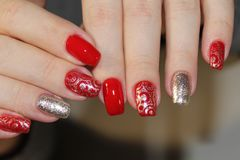 Perfect manicure and natural nails. Attractive modern nail art design. Gel polish applied Stock Photo