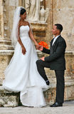 Perfect Match. A young black girl dressed in a wonderful luxurious wedding dress and a veil with loving eyes is looking at her fiance. A dark-skinned men with a Stock Photography