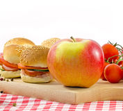 Perfect meal in any time and anyone. Small sandwiches on a table and apple royalty free stock photography