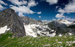 Spring on the Durmitor mountain. Perfect mix of green grass, snow and rock in the heart of the Dinaric Alps stock photos