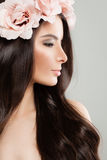 Perfect Model with Beautiful Hairstyle and Rose Flower. Long Hair and Makeup Stock Photos
