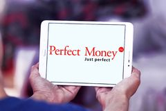 Perfect Money bank logo. Logo of Perfect Money payment system on samsung tablet Royalty Free Stock Photo