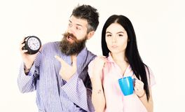 Perfect morning concept. Girl with coffee cup, man holds clock in hand. Couple, family woke up on time. Couple in love. Perfect morning concept. Girl with coffee stock image