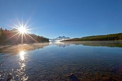 A perfect mountain lakeside morning royalty free stock photography