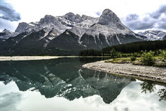 Perfect Mountain Reflections. In a lake by Canmore Alberta royalty free stock photography