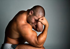 A perfect muscular man posing artistic. Studio shot stock photo