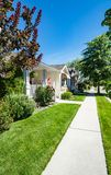 Perfect neighbourhood. Concrete paved pathway in residential area on sunny day. In British Columbia stock photography