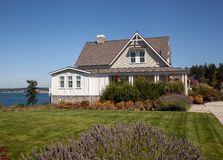 Perfect new home. A new home with a large lawn and fronted by lavender on a bay makes a perfect new home on a blue sky day Royalty Free Stock Images