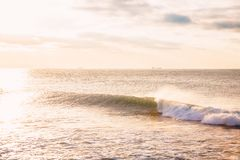 Perfect ocean wave. Landscape with sunrise or sunset colors. Perfect ocean wave. Landscape with sunrise or sunset Royalty Free Stock Image