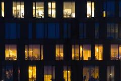 Perfect office building windows at dusk pattern many similar. Night illumination stock image