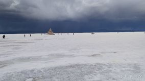 Perfect onweer in Salar van Uyuni stock foto