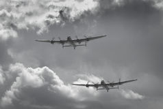 The perfect pair of Lancaster bombers. These historic aircraft were integral to the British war effort against nazi Germany. Here they are flying to commemorate Stock Images