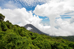 The perfect peak of the active and young Izalco volcano seen fro. M a view point in Cerro Verde National Park in El Salvador. Nearly covered with thick white Royalty Free Stock Photography