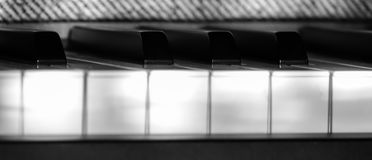 Perfect Piano keys in mild sunlight extreme close up. Multiple beautiful detailed views of piano keys and notes and sheet music with mild play of the sun and royalty free stock image