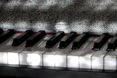 Perfect Piano keys in mild sunlight with grey cover. Multiple beautiful detailed views of piano keys and notes and sheet music with mild play of the sun and royalty free stock photography