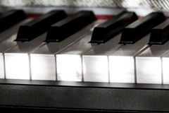 Perfect Piano keys in mild sunlight with grey cover. Multiple beautiful detailed views of piano keys and notes and sheet music with mild play of the sun and Royalty Free Stock Photos