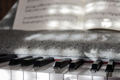 Perfect Piano keys in mild sunlight with notation. Multiple beautiful detailed views of piano keys and notes and sheet music with mild play of the sun and stock image