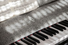 Perfect Piano keys in mild sunlight with notation royalty free stock photo