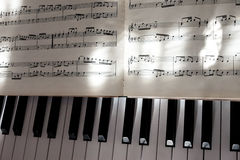 Perfect Piano keys in mild sunlight with notation. Multiple beautiful detailed views of piano keys and notes and sheet music with mild play of the sun and stock photo