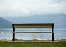 A perfect place to meditate. Empty bench facing Harrison lake Royalty Free Stock Image