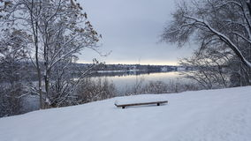 The perfect place to sit. Snow covered bench overlooking the Columbia River Stock Photos