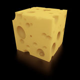 A Perfect Portion of Swiss Cheese. Close-up of a cube of Swiss cheese on black background with clipping path Royalty Free Stock Photography
