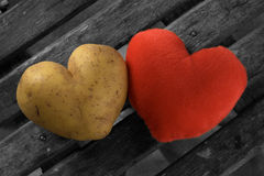 Perfect potato heart with a red heart Stock Images